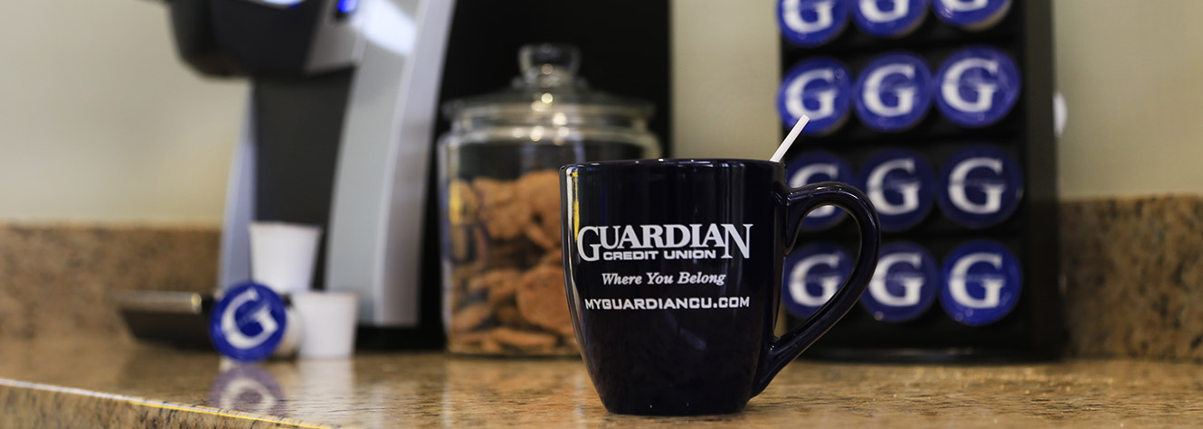 Guardian coffee mug pictured linking to Guardian Credit Union Careers