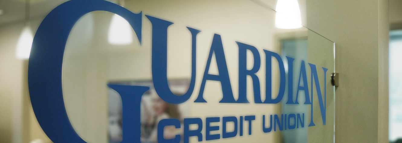 Image of blue Guardian Credit Union logo on glass window